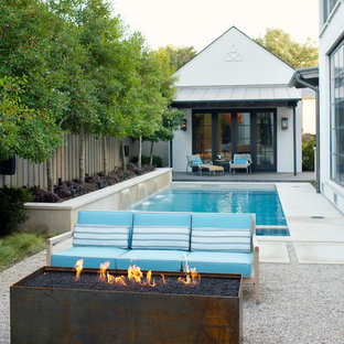 This is an example of a medium sized contemporary side patio in Dallas with a water feature and an awning.