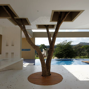 Inspiration for a modern patio remodel in Other with a roof extension