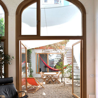 Design ideas for a medium sized courtyard patio in Barcelona with gravel and an awning.