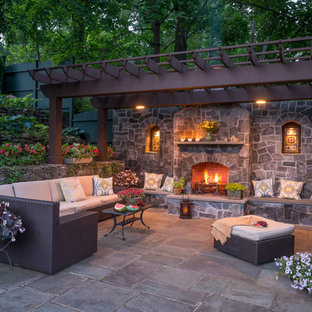 Example of a huge classic patio design in New York with a fire pit and a pergola