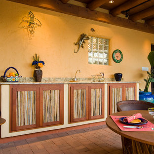 Photo of a medium sized mediterranean courtyard patio in Phoenix with an outdoor kitchen, brick paving and a gazebo.