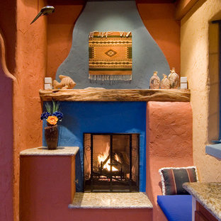 Example of a mid-sized tuscan courtyard concrete paver patio kitchen design in Phoenix with a gazebo