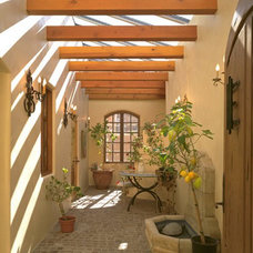 Mediterranean Patio by Archaeo Architects
