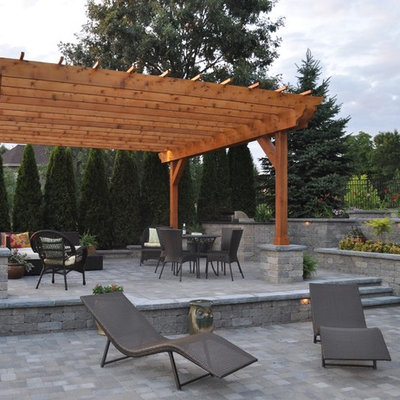 Example of a mid-sized trendy backyard brick patio kitchen design in Chicago with a gazebo