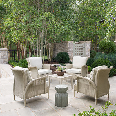 Inspiration for a timeless backyard stone patio remodel in Charlotte with no cover