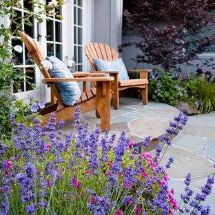 Mid-sized elegant backyard stone patio photo in San Francisco
