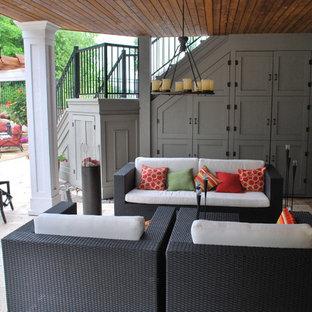Patio - contemporary stone patio idea in Minneapolis