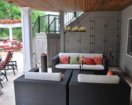 contemporary patio idea in minneapolis with natural stone pavers - Patio Ideas Under Deck
