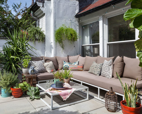 small eclectic backyard concrete patio photo in new york - Design Backyard Patio