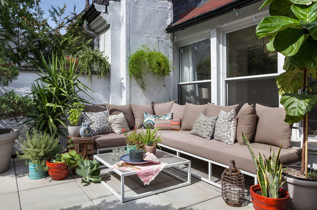 Eclectic Patio by Lorla Studio