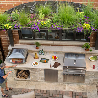 Example of a small classic backyard brick patio kitchen design in Chicago