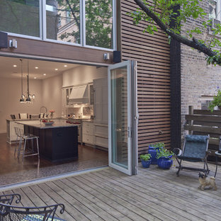Patio - large modern backyard patio idea in Chicago with decking and no cover
