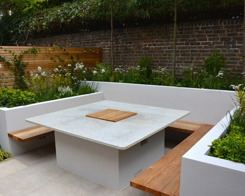 inspiration for a small contemporary backyard stone patio remodel in london - Small Backyard Design Ideas