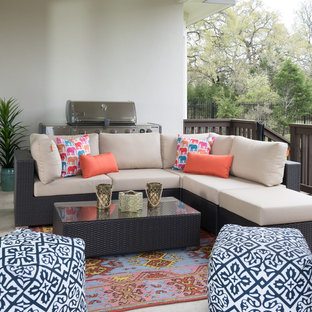 Example of an eclectic patio design in Austin with a roof extension