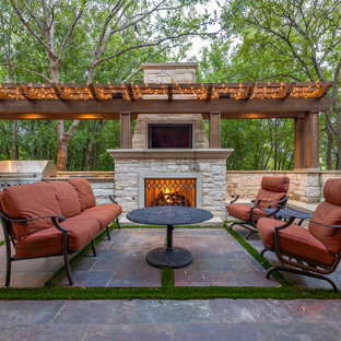 Elegant patio photo in Dallas with a fire pit