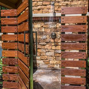 Esempio di un patio o portico stile rurale con nessuna copertura