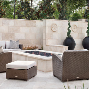 Example of a huge tuscan backyard patio design in Houston with a fire pit and no cover