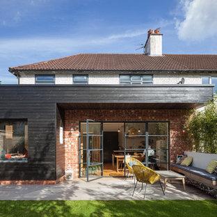Design ideas for a medium sized contemporary patio in Manchester.