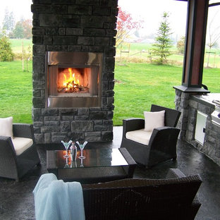 Inspiration for a timeless patio remodel in Vancouver with a fire pit