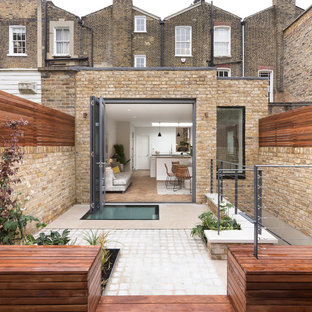 Photo of a medium sized contemporary patio in London with no cover.