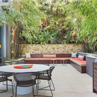 Inspiration for a contemporary patio in Sydney with an outdoor kitchen and no cover.