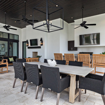 Patio kitchen - large contemporary backyard concrete paver patio kitchen idea in Miami with a roof extension