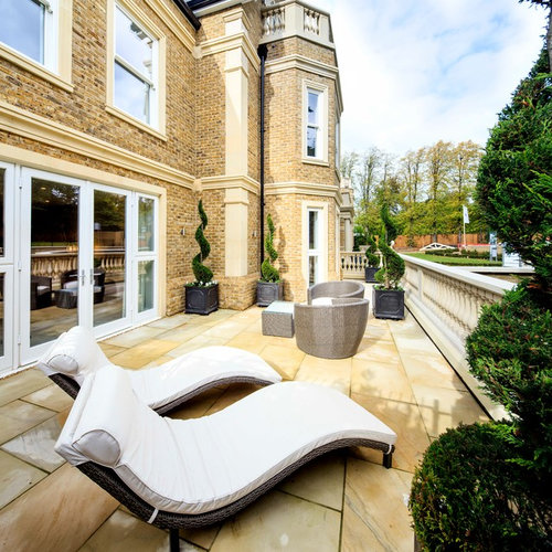 This Is An Example Of A Classic Patio In London With Natural Stone Paving  And No