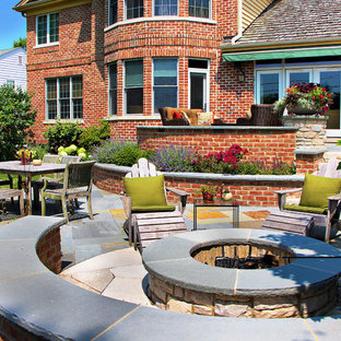 Inspiration for a classic back patio in Chicago with natural stone paving and a fire feature.
