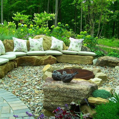 Inspiration for a large timeless backyard gravel patio remodel in Cleveland with a fire pit and no cover