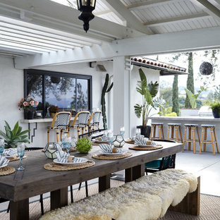 Mid-sized trendy backyard patio kitchen photo in Los Angeles with a roof extension