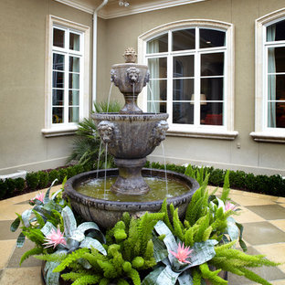 Inspiration for a timeless tile patio fountain remodel in Charleston
