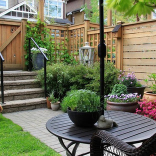 Inspiration for a timeless brick patio container garden remodel in San Diego with no cover