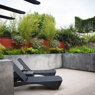 Inspiration for a contemporary courtyard patio remodel in London