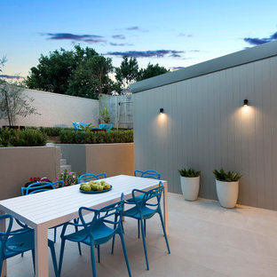 Photo of a contemporary courtyard patio in Sydney with no cover.