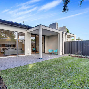 Inspiration for a contemporary backyard patio in Adelaide with brick pavers and a roof extension.
