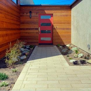 Immagine di un piccolo patio o portico design davanti casa con pavimentazioni in cemento