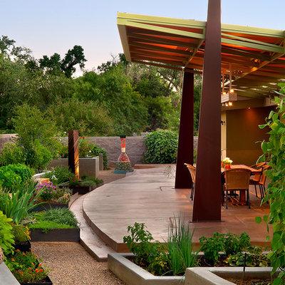 Patio - contemporary patio idea in Albuquerque with a roof extension