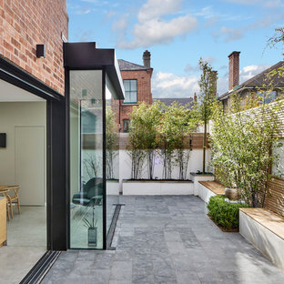 Photo of a medium sized contemporary back patio in Dublin with no cover.