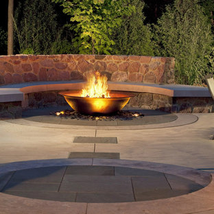 Inspiration for a large craftsman backyard stone patio remodel in Milwaukee with a fire pit