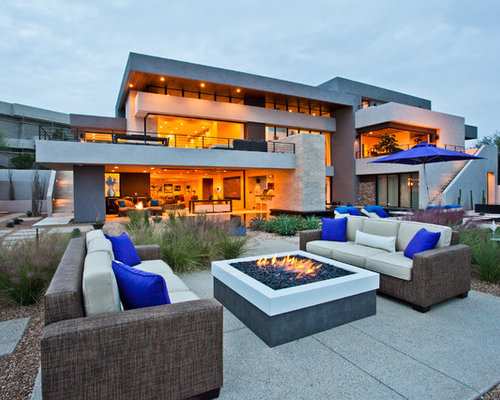 Inspiration For A Contemporary Backyard Concrete Patio Remodel In Las Vegas  With A Fire Pit