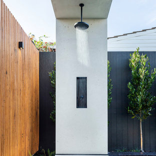 This is an example of a contemporary backyard patio in Adelaide with an outdoor shower and concrete slab.
