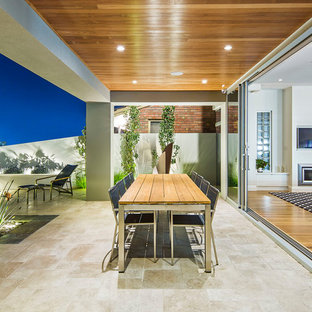 Design ideas for a contemporary backyard patio in Adelaide with a roof extension and natural stone pavers.