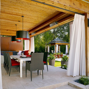 Patio - contemporary patio idea in London with a pergola