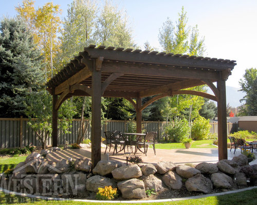 Example Of A Trendy Backyard Patio Design In Salt Lake City With Pergola