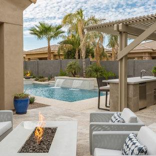 Trendy backyard patio kitchen photo in Phoenix with a pergola