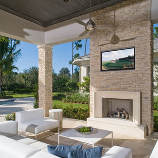 Inspiration for a transitional backyard patio remodel in San Diego with a fire pit and a roof extension