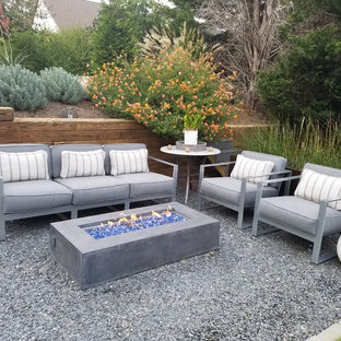 Example of a trendy gravel patio design in Atlanta with a fire pit and no cover