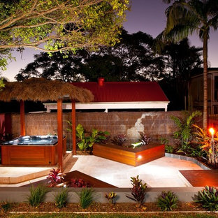 Design ideas for a tropical patio in Brisbane with no cover.