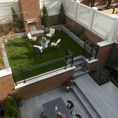 Example of a classic patio design in Chicago with a fire pit