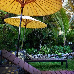 Ispirazione per un patio o portico etnico di medie dimensioni